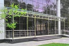 Светопрозрачный навес из стекла и полированой нержавеющей стали для стеклянного фасада.
